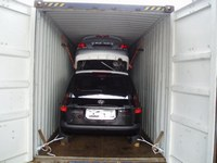 international shipping cars inside of containers